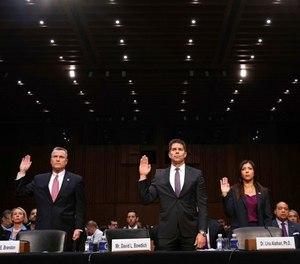Thomas Brandon, deputy director of the Bureau of Alcohol, Tobacco, Firearms and Explosives, left, David Bowdich, associate deputy director of the Federal Bureau of Investigation, and Lina Alathari, a researcher with the U.S. Secret Service, are sworn in to testify at a Senate Judiciary Committee hearing on the Parkland, Fla., school shootings and school safety, Wednesday, March 14, 2018, on Capitol Hill in Washington. (AP Photo/Jacquelyn Martin)