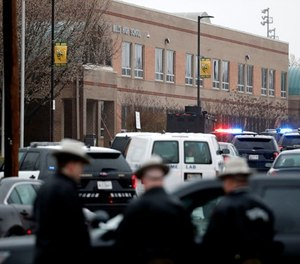 Deputies and federal agents converge on Great Mills High School, the scene of a shooting, Tuesday morning, March 20, 2018 in Great Mills, Md. The shooting left three people injured including the shooter. Authorities said the situation was