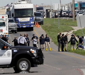 Officials continue to investigate the scene where a suspect in a series of bombing attacks in Austin blew himself up as authorities closed in, Wednesday, March 21, 2018, in Round Rock, Texas.