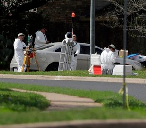 In this March 19, 2018, file photo, federal investigators work near the site of an explosion in Austin, Texas.