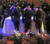 Slain Dallas officer remembered as hero during funeral