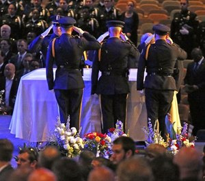 Colleagues salute their fallen comrade at the funeral for Dallas Police Officer Officer Rogelio Santander at Lake Pointe Church in Rockwall, Texas on Tuesday, May 1, 2018. Santander was shot and killed at a Home depot in Dallas last week.