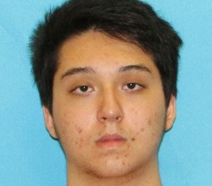 This photo provided by the Collin County District Attorney's office in Texas shows Matin Azizi-Yarand, a teenager from Plano, Texas, who has been charged with criminal solicitation of capital murder and making a terroristic threat. (Collin County District Attorney's office via AP)