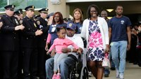 Charity pays off mortgage for NYPD officer seriously injured after being dragged by stolen car