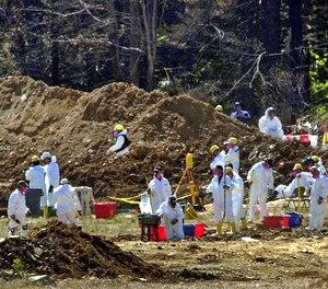 FBI investigators continue excavating the crash site of United Flight 93 in Shanksville, Pa.