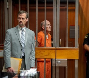 Defense attorney Joe Cress stands next to his client Joseph James DeAngelo appears in Sacramento Superior Court, Friday, June 1, 2018, in Sacramento, Calif. He is suspected in at least a dozen killings and roughly 50 rapes in the 1970s and '80s. (José Luis Villegas/The Sacramento Bee via AP, Pool)