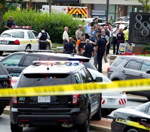 Authorities stage at the office building entrance after multiple people were shot at The Capital Gazette newspaper in Annapolis, Md., Thursday, June 28, 2018.