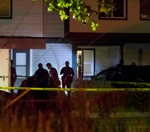 Boise police investigate at a crime scene near the corner of State and Wyle Streets in Boise just before 11:00 p.m. Saturday, June 30, 2018. (Darin Oswald/Idaho Statesman via AP)
