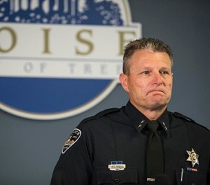 Boise Police Chief Bill Bones becomes reacts while releasing child victims' ages at a news conference for Saturday's stabbing attack that happened in Boise, at Police and Fire City Hall of Boise in Boise, Idaho, Sunday, July 1, 2018. (Meiying Wu/Idaho Statesman via AP)