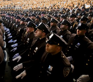 Members of New York Police Academy's July 2018 graduating class are seated during their graduation ceremony, Monday July 2, 2018, in New York.