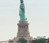 Protester holds police at bay after climbing Statue of Liberty