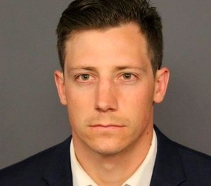 This undated file photo provided by the Denver Police Department shows Chase Bishop. Investigators say the FBI agent accidentally fired a weapon that fell while he was dancing at a Denver nightspot and wounded another patron in the leg. (Denver Police Department via AP, File)