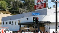 Deadly LA market shooting started with domestic feud