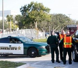 Broward County Sheriff's deputies stand outside Marjory Stoneman Douglas High School, Wednesday, Aug. 15, 2018, in Parkland, Fla. Students at the school returned Wednesday, to a more secure campus as they began their first new school year since a gunman killed 17 people in the freshman building. (AP Photo/Wilfredo Lee)
