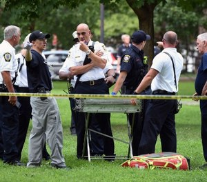 "New Haven emergency personnel respond to overdose cases on the New Haven Green in Connecticut on Wednesday, Aug. 15, 2018. More than 30 people overdosed Wednesday from a suspected bad batch of ""K2"" synthetic marijuana at or near a city park in Connecticut. No deaths were reported, but officials said two people had life-threatening symptoms. (Arnold Gold/New Haven Register via AP)"