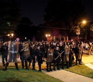 In this Sept. 15, 2017 file photo, police line up as protesters gather, in St. Louis, after a judge found Jason Stockley, a white former St. Louis police officer, not guilty of first-degree murder in the death of Anthony Lamar Smith, a black man, who was fatally shot following a high-speed chase in 2011.