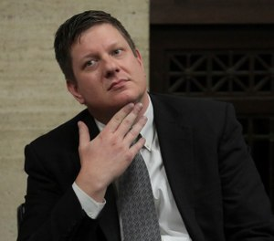 Chicago police Officer Jason Van Dyke listens while attorneys step before Judge Vincent Gaughan bench, as the jury has sent another question to Judge Gaughan, who read it aloud from the bench during deliberations in Van Dyke's trial at the Leighton Criminal Court Building, Friday, Oct. 5, 2018, in Chicago. Van Dyke is charged with first-degree murder, aggravated battery and official misconduct in the shooting of Laquan McDonald. (Antonio Perez/ Chicago Tribune via AP, Pool)