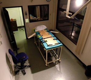 In this Nov. 20, 2008, file photo, the execution chamber at the Washington State Penitentiary is shown with the witness gallery behind glass at right, in Walla Walla, Wash. Washington state's Supreme Court has ruled that the death penalty violates its Constitution. The ruling Thursday, Oct. 11, 2018, makes Washington the latest state to do away with capital punishment. They ordered that people currently on death row have their sentences converted to life in prison. (AP Photo/Ted S. Warren, File)