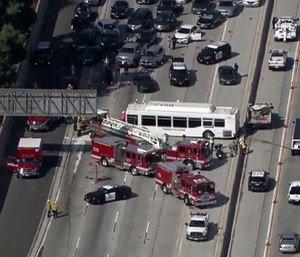 This aerial image made from video provided by KABC-TV shows the wreckage of a bus accident along Interstate 405 in Los Angeles. (Photo/AP)