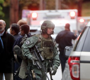 Armed police move through the streets of the Squirrel Hill neighborhood of Pittsburgh where a shooter opened fire during services at the Tree of Life Synagogue on Saturday, Oct. 27, 2018.