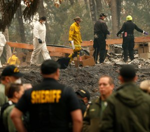 Some 52,000 people have been displaced to shelters, the homes of friends and relatives, to motels — and to a Walmart parking lot and an adjacent field in Chico, a dozen miles away from the ashes. (Photo/AP)