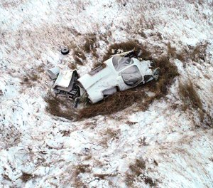 This Monday, Nov. 19, 2018, photo shows the wreckage of a twin-engine Bismarck Air Medical airplane that crashed late Sunday, Nov. 18, killing all three on board. An NTSB report states that pilot error was the probable cause of the crash.