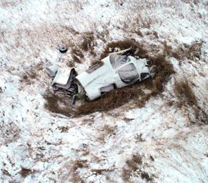 This photo shows the wreckage of a Bismarck Air Medical airplane that crashed on Nov. 18, 2018, killing Paramedic Chris Iverson, Nurse Bonnie Cook and Pilot Todd Lasky. The NTSB said in a recent report that a structural failure led to the crash. (Photo/Morton County Sheriff's Office via AP)