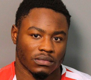 "This Monday, Dec. 3, 2018 booking photograph provided by the Jefferson County Sheriff's Office in Birmingham, Ala., shows Erron Brown, who is charged with attempted murder in a shooting at a shopping mall on Thanksgiving. Police in Hoover, Ala., shot and killed another black man, Emantic ""EJ"" Bradford Jr., mistaking him for the shooter after the shots rang out. (AP Photo/Jefferson County Sheriff's Office)"