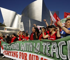 United Teachers Los Angeles leaders are joined by thousands of teachers as they march past the Walt Disney Concert Hall downtown Los Angeles.