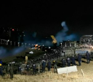 In this Nov. 20, 2016, file photo, provided by Morton County Sheriff's Department, law enforcement and protesters clash near the site of the Dakota Access oil pipeline in Cannon Ball, N.D. (Morton County Sheriff's Department via AP, File)