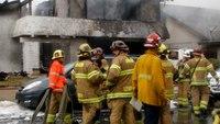 5 killed, 2 injured after plane breaks apart over neighborhood