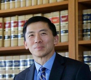 In this Jan. 13, 2017 file photo California Supreme Court Associate Justice Goodwin Liu pauses in his office in San Francisco. (AP Photo/Jeff Chiu, File)