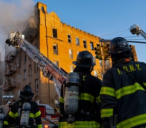 FDNY firefighters battle a multi alarm fire in the Sunset Park neighborhood of Brooklyn Wednesday, April 3, 2019, in New York. (AP Photo/Craig Ruttle)