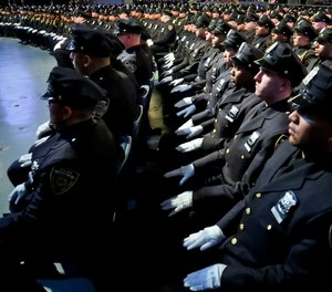 New York City Police Academy graduates sit in formation during graduation ceremony for new members of the NYPD, Thursday April 18, 2019, in New York.