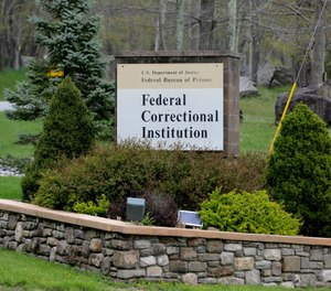 In this May 1, 2019 photo, a sign marks the entrance to the Federal Correctional Institution, Otisville in Mount Hope, N.Y. President Donald Trump's former lawyer and fixer, Michael Cohen, is due to report to the facility on Monday, May 6, 2019, to begin serving a three year sentence for tax evasion, lying to Congress and campaign finance crimes. (AP Photo/Seth Wenig)