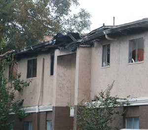 The scene of a fatal apartment fire at the Captiva Club apartments in Town 'n Country early Wednesday morning, May 15, 2019 in Tampa, Fla. Hillsborough County Fire Rescue crews and sheriff's deputies responded to a call at 3:23 a.m. about a fire at the Captiva Club Apartments. They arrived within minutes to find flames penetrating the roof of Building 3 and a wall collapsed, according to a news release from Hillsborough Fire Rescue. (Octavio Jones/Tampa Bay Times via AP)