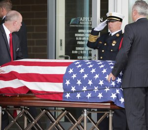 The casket of Appleton firefighter Mitchell F. Lundgaard appears at the Appleton Alliance Church on Monday, May 20, 2019, in Grand Chute, Wis. The 14-year veteran of the Appleton Fire Department was fatally shot while responding to a medical emergency at the downtown Valley Transit Center on May 15, in Appleton, Wis.