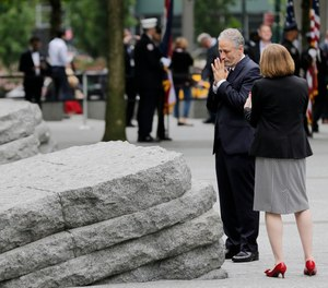 John Stewart talks with Alice Greenwald, CEO of the National September 11 Memorial & Museum, before the start of a dedication ceremony in New York, Thursday, May 30, 2019. Former New York City Mayor Michael Bloomberg says the new memorial glade at the World Trade Center site