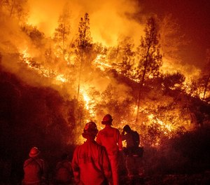 In this Aug. 7, 2018 file photo, firefighters monitor a backfire while battling the Ranch Fire, part of the Mendocino Complex Fire near Ladoga, Calif. (AP Photo/Noah Berger, File)