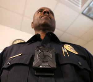 One researcher recommends every patrol officer on a department is equipped with body cameras. (AP Photo/Ross D. Franklin)