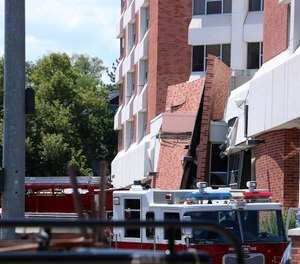 Rescue personnel respond to an explosion that damaged Argenta Hall and Nye Hall on the University of Nevada, Reno campus on July 5, 2019, in Reno, Nev. A utilities explosion caused the partial collapse of a dormitory building and at least minor injuries, authorities said. (Jason Bean/The Reno Gazette-Journal via AP)