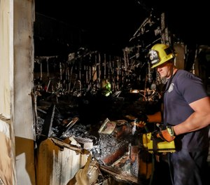 A firefighter looks over a home that burned after a earthquake in Ridgecrest, Calif. (AP Photo/Marcio Jose Sanchez)