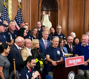 Entertainer and activist Jon Stewart speaks at a news conference on behalf of 9/11 victims and families at the Capitol in Washington. (AP Photo/Matthew Daly)