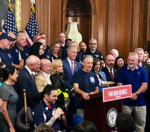 Entertainer and activist Jon Stewart, speaks at a news conference on behalf of 9/11 victims and families at the Capitol in Washington. (AP Photo/Matthew Daly)