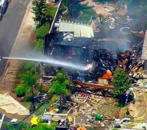 This image from video provided by CBS-LA shows the aftermath of an explosion that destroyed a house in Murrieta, Calif., sending up thick flames and closing several streets.