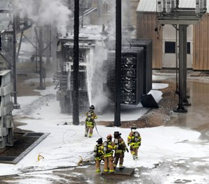 Members of the Madison Fire department respond at the scene of a fire at Madison Gas and Electric. (Steve Apps/Wisconsin State Journal via AP)
