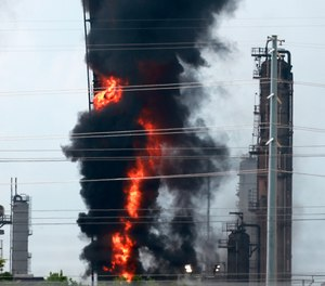 Flames and smoke emanate from an Exxon Mobil facility in Baytown, Texas.