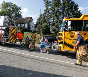 First responders rest after responding to an explosion believed to have been caused by a gas leak that reduced a western Pennsylvania home to a pile of rubble and sent several people to the hospital. (AP Photo/Keith Srakocic)