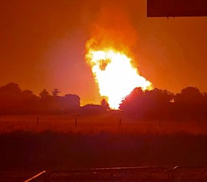 A regional gas pipeline ruptured early Thursday in Kentucky, causing a massive explosion that killed one person, hospitalized five others, destroyed railroad tracks and forced the evacuation of a nearby mobile home park, authorities said. (Photo/Naomi Hayes via AP)