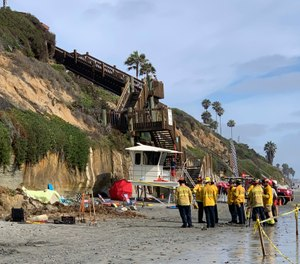 Lifeguards and search and rescue personnel work at the site of a cliff collapse at a popular beach in Encinitas, Calif. (Photo/Hayne Palmour/The San Diego Union-Tribune via AP)